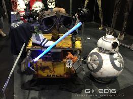 Wall-E holding a lightsabre