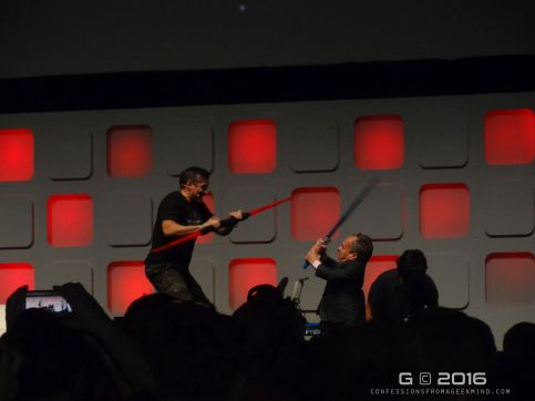 Ray Park and Warwick Davis recreate the Jedi and Sith fight from The Phantom Menace